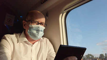 Train passenger wearing a mask.